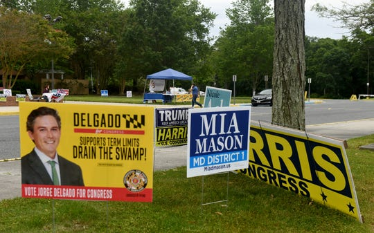 Signs dot the grass in front of the Wicomico Civic Center in Salisbury on Primary Election Day, June 2, 2020.
