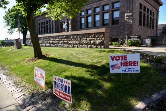 Signs are seen during the elections on Tuesday, June 2, 2020 at Carnegie Town Hall in Sioux Falls, S.D.