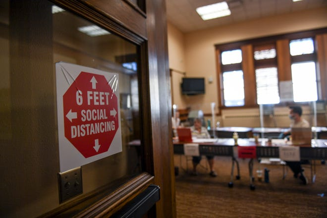 Voters are advised to socially distance as they vote during the elections on Tuesday, June 2, 2020 in Sioux Falls, S.D.