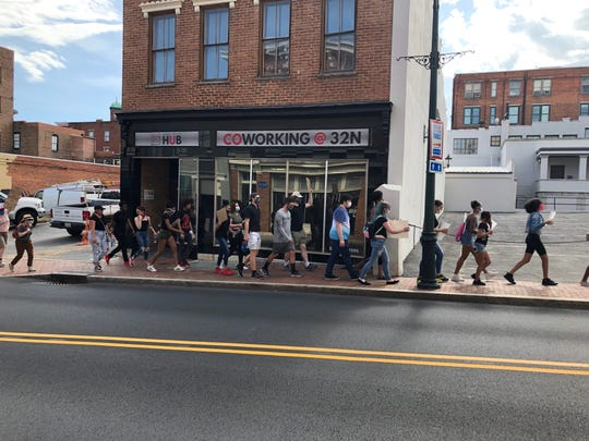 Silent marchers continued walking along North Augusta Street.