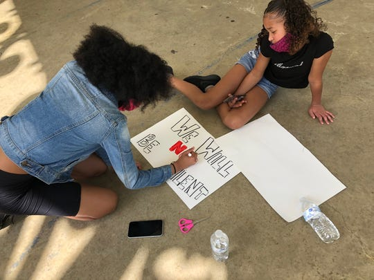 Ky'nasia White, 15, Staunton, drew a message on her poster: We will not be silent.