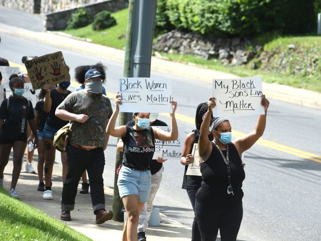 Protesters held a silent march Tuesday, June 2, in downtown Staunton to bring attention to racial injustice and the death of George Floyd.
