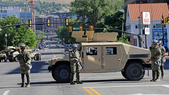 Utah National Guard troops are shown, Monday, June 1, 2020, in Salt Lake City. Approximately 200 Utah National Guard members have been activated by order of Utah Governor, Gary R. Herbert, to assist local law enforcement agencies in response to violence and looting in downtown Salt Lake City to deter criminal activity and protect life and property. (AP Photo/Rick Bowmer)