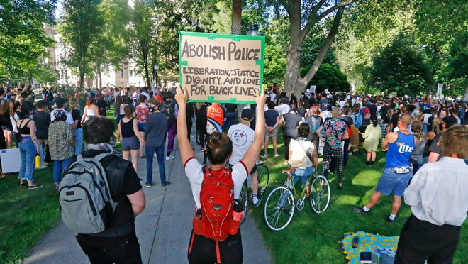 Protesters take part in a peaceful demonstration Monday, June 1, 2020, in Salt Lake City, sparked by the death of George Floyd, who died May 25 after being restrained by Minneapolis police. (AP Photo/Rick Bowmer)