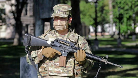 Utah National Guardsman stands on guard, Monday, June 1, 2020, in Salt Lake City. Approximately 200 Utah National Guard members have been activated by order of Utah Governor, Gary R. Herbert, to assist local law enforcement agencies in response to violence and looting in downtown Salt Lake City to deter criminal activity and protect life and property. (AP Photo/Rick Bowmer)