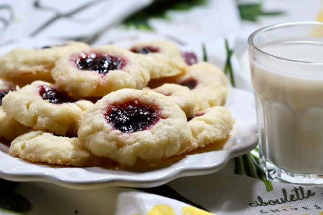 Blueberry Thumbprint Cookies with a Lemon Glaze are easy to make.