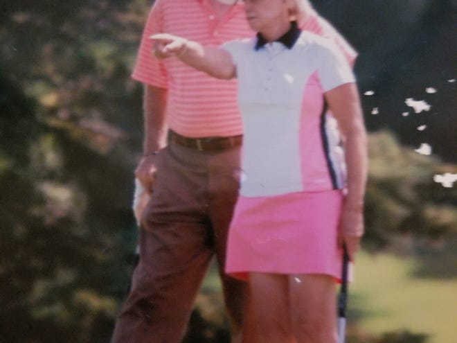 Dan Wood on the golf course with his wife Sandi.