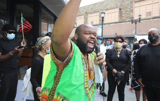 Westchester County Legislator Christopher Johnson speaks to a group of protesters in Yonkers' Getty Square June 2, 2020.