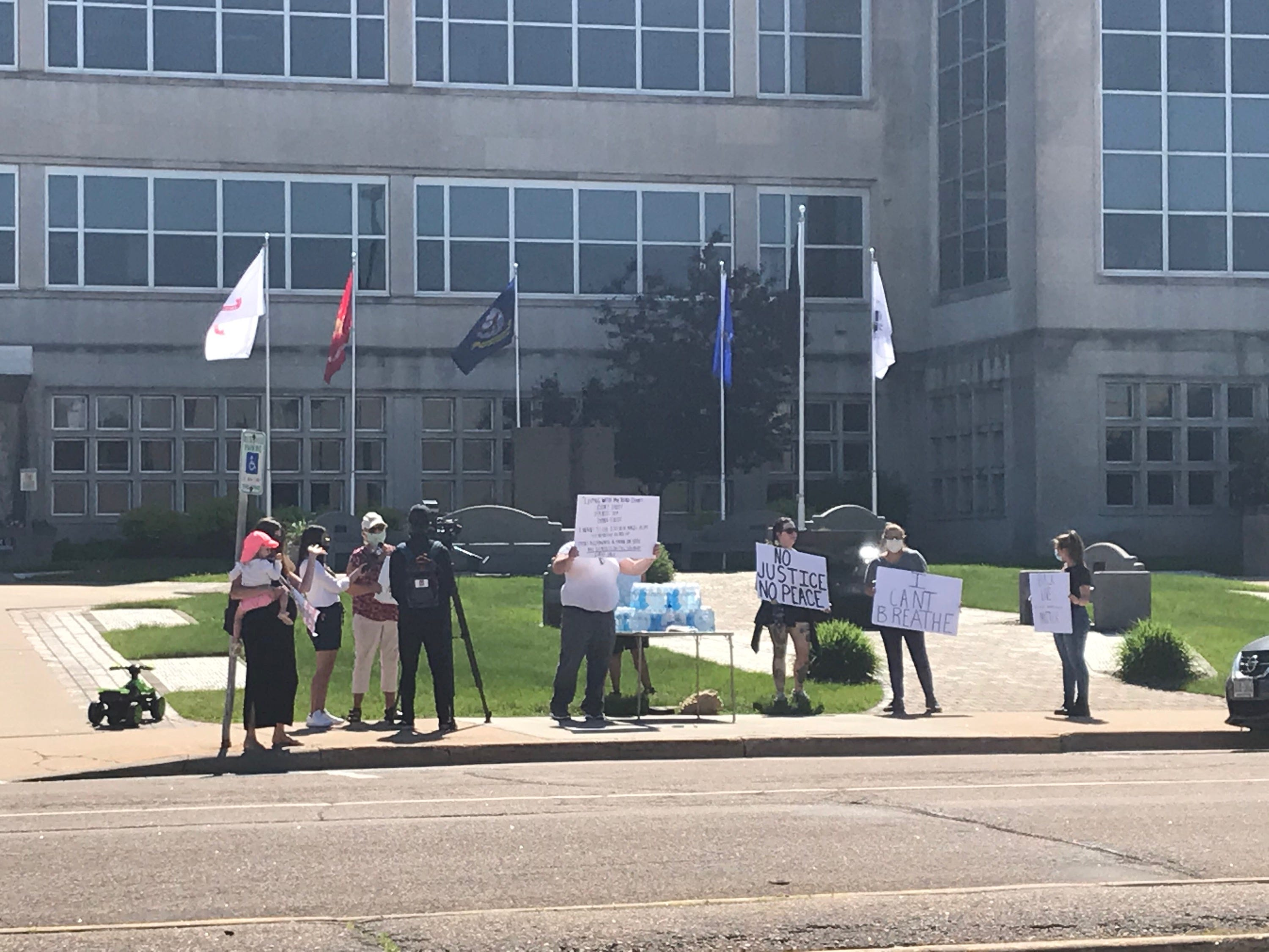About a dozen people gather in front of the Wood County Courthouse in Wisconsin Rapids Tuesday morning as part of the #JusticeForFloyd Peaceful Protest. The event was scheduled from 10 a.m. to 6 p.m.