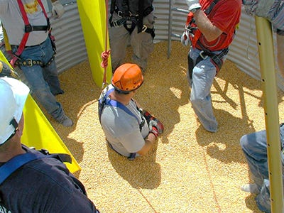 Safety training that focused on use of harnesses and other equipment is held each year by experts at Purdue University who show farmers how to be safe in and around grain bins.