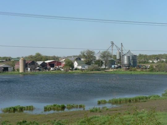 The Mabie Dairy, just west of Stoughton, was always a scenic attraction from Highway 138.  The farm is now gone with a shopping center replacing it and the pond has long dried up.