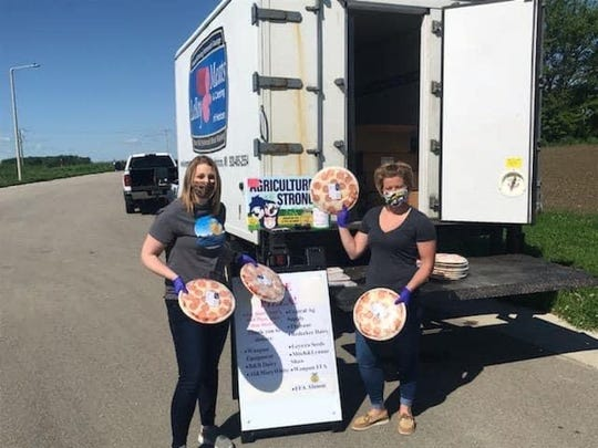 For six weeks now, the Waupun FFA and Alumni have teamed up with area businesses and individual donors to help supply the surrounding community with agricultural products during the Ag Products Giveaway. From gallons of milk to cheese curds and sausage to most recently 1300 pizzas donated by Leroy Meats and Catering, Eden Meat Market, Park Plaza Pizza and Tony's Pizza.