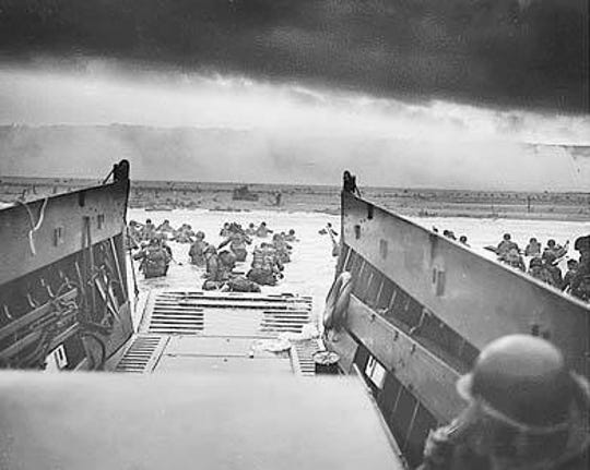 Mabie and his fellow soldiers clambered over the side of Higgins boat to escape enemy fire before the door was opened.