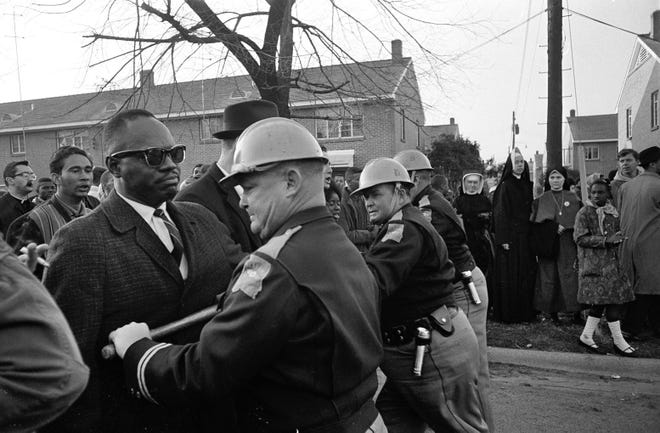 In this March 13, 1965 file photo, police block demonstrators attempting to push through their cordon in Selma, Ala. during a protest for voting rights.