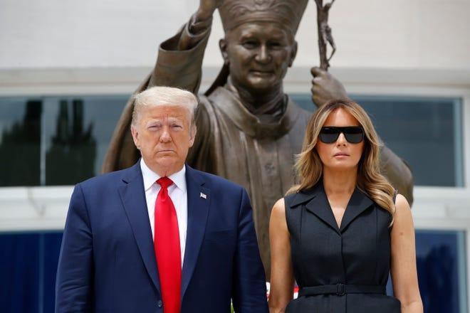 President Donald Trump and first lady Melania Trump visit Saint John Paul II National Shrine, Tuesday, June 2, 2020, in Washington.