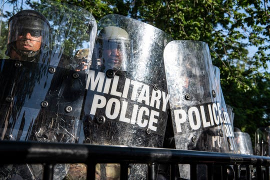 A cadre of law enforcement including Park Police, Metro Police Department and D.C. National Guard face off with protesters across barriers in Lafayette Square just in front of the White House in Washington, D.C. on June 1, 2020.