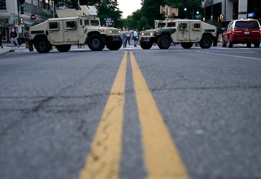 Two military humvees block a roadway near the White House during protest on June 1, 2020 in Washington, DC.