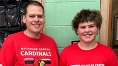 Jackson, Michigan school teacher Corey Shelton, seen here with his son Logan, is concerned about the future of his public pension in the wake of the coronavirus.