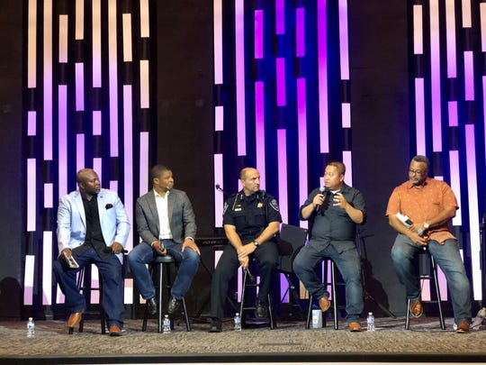 From left to right, the Revs. Alvin Dupree of Family First Ministries, Charles Butler of Breakthrough Covenant Church, Appleton Police Chief Todd Thomas, Revs. Bee Vang of Refuge Church and Joseph Butler of Bethel Worship Center, talk about racism at a panel Tuesday at Breakthrough Convenant Church.
