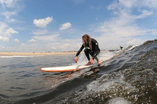 Lamb of God singer Randy Blythe, pictured surfing in Asbury Park.