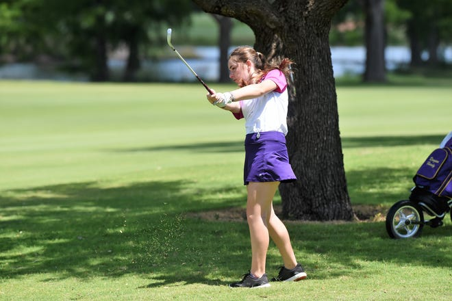 Reagan Hardy, of Abilene, hits a shot on No. 18 during the first round of the WTJCT West Texas Junior Open last year at the Abilene Country Club South Course. She tied for sixth in the girls ages 15-18 division Thursday.