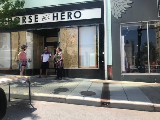 Damage to businesses during May 31 and June 1 protests included broken windows.