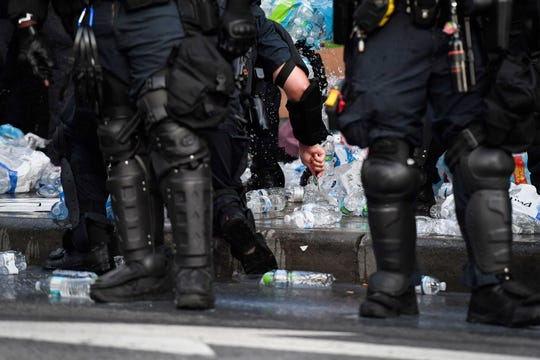 Asheville police stab water bottles with knives and tip over tables of medical supplies and food at a medic station created by protesters June 2.
