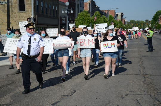 Led by Marshall Public Safety Director Scott McDonald, about 250 people walk through downtown on Tuesday.  Trace Christenson/The Enquirer