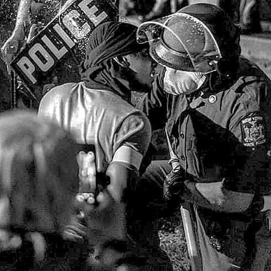 Talon Thomas, Binghamton, kneels with a New York State Trooper Tuesday, June 2, 2020 in front of the Binghamton Police Department during a peaceful protest. After kneeling, Thomas and the officer hugged.