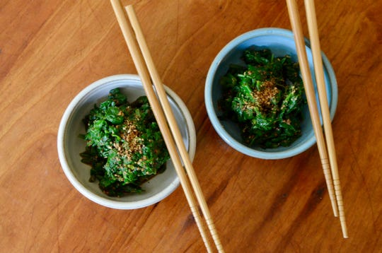 Blanching greens like spinach, kale and even the tender young nettles creates this simple greens and sesame salad.