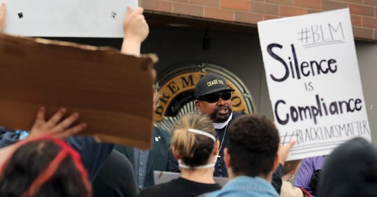 Pastor Richmond Johnson with Mount Zion Missionary Baptist Church addresses the crowd of protestors gathered at the Bremerton Police Department headquarters on Tuesday.