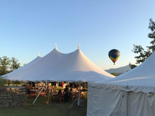 A tent set up by Blood's Catering and Party Rentals on Tinkham Hill Farm, a wedding venue in Hartland.