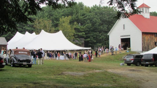 A 60-foot by 90-foot wedding tent, provided by Blood's Catering and Party Rental.