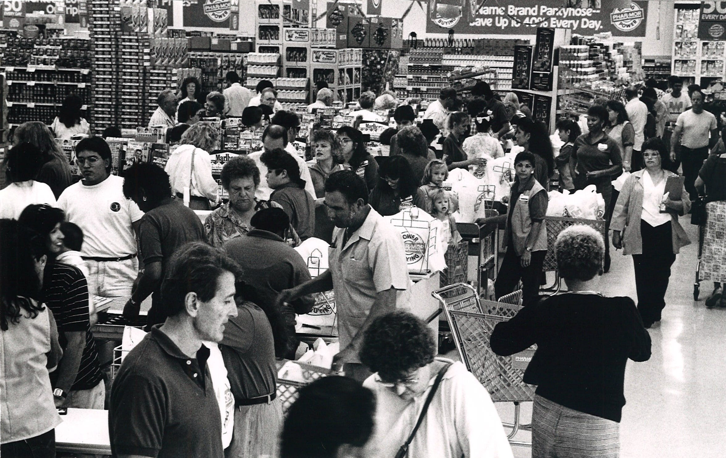 Customers lined up to checkout during the opening of Phar-Mor in Moore Plaza on Sept. 13, 1989.