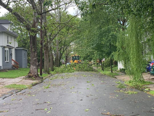 A  front loader clears trees from Maple Avenue in Collingswood.
