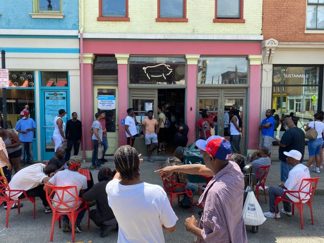 People line up outside of Eli's BBQ in Findlay Market on Wednesday, June 3, 2020. Eli's BBQ offered free meals to black people in the Cincinnati community on Wednesday, following days of protests in the city in response to the death of George Floyd.