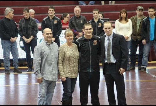 Mike Dessino and his parents at Bloomsburg