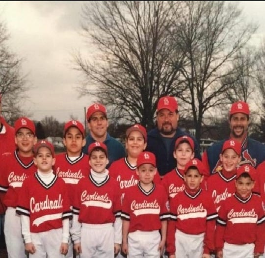 ~Mike Dessino (on bottom row second from the left in front of his dad) with his Little League team
