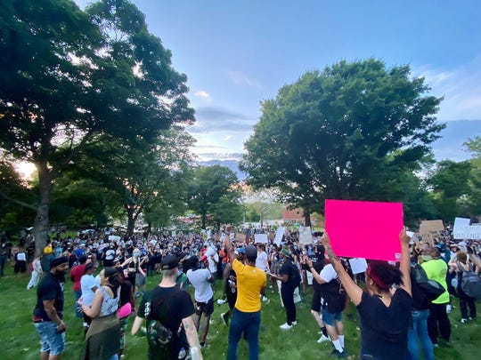 About 1,000 people march from the sculpture park in downtown Des Moines to Terrace Hill, the governor's mansion, on Tuesday.