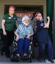 (L to R) Oakmont Parkway senior community activity director, Barb Bash, Lucille Grewe and Bette Kenward, President of the W.O.W. Chapter of the American Rosie the Riveter Association smiled and posed during the birthday celebration for 108-year-old, Lucille on June 2, 2020.