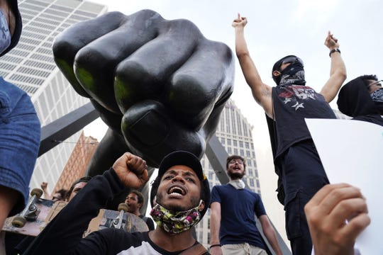 Protesters march through Detroit on the sixth day of protests against police brutality on Wednesday, June 3, 2020.