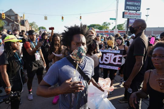 Tristan Taylor of Detroit moves amongst protesters marching along Gratiot Ave. in Detroit during the fifth day of protesting in Detroit on June 2, 2020.