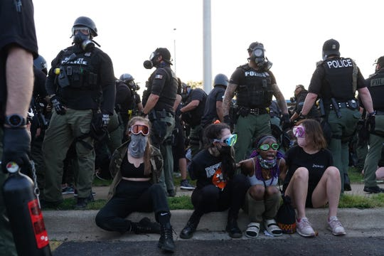 Detroit Police officers make arrests during the fifth day of protests against police brutality on Tuesday, June 2, 2020.