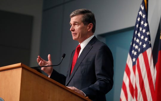 North Carolina Gov. Roy Cooper speaks Tuesday during a briefing at the Emergency Operations Center in Raleigh, N.C.