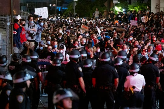 Police block protesters from exiting the Manhattan Bridge in New York, Tuesday, June 2, 2020. New York City extended an 8 p.m. curfew all week as officials struggled Tuesday to stanch destruction and growing complaints that the nation's biggest city was reeling out of control night by night.