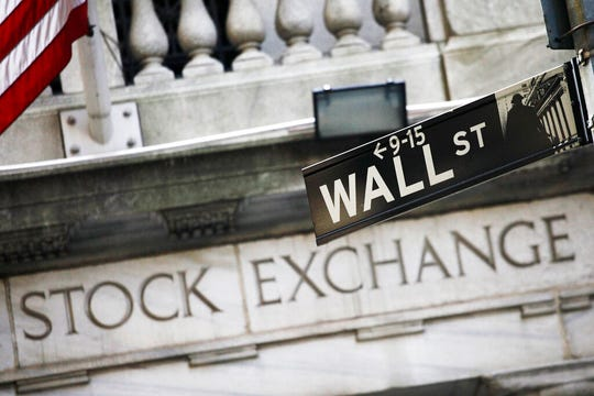 A street sign for Wall Street outside the New York Stock Exchange in New York.