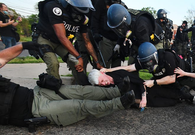 Protesters are taken down by Detroit police after violating curfew, which they did on purpose in order to get arrested, on Gratiot Avenue near Outer Drive in Detroit, Michigan on June 2, 2020.