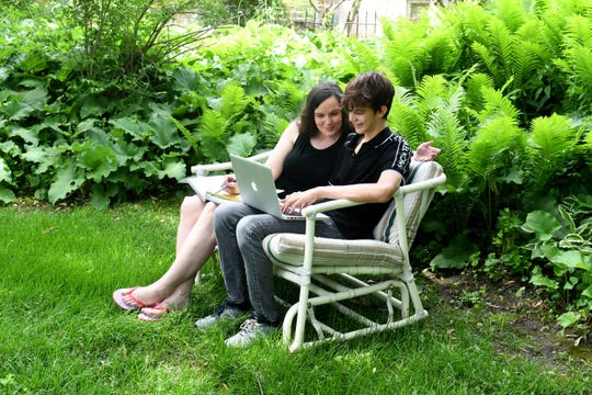 Erin Eagen, and her son Xavier, study in their family backyard as he continues his school work in Southfield on Wednesday, June 3, 2020.