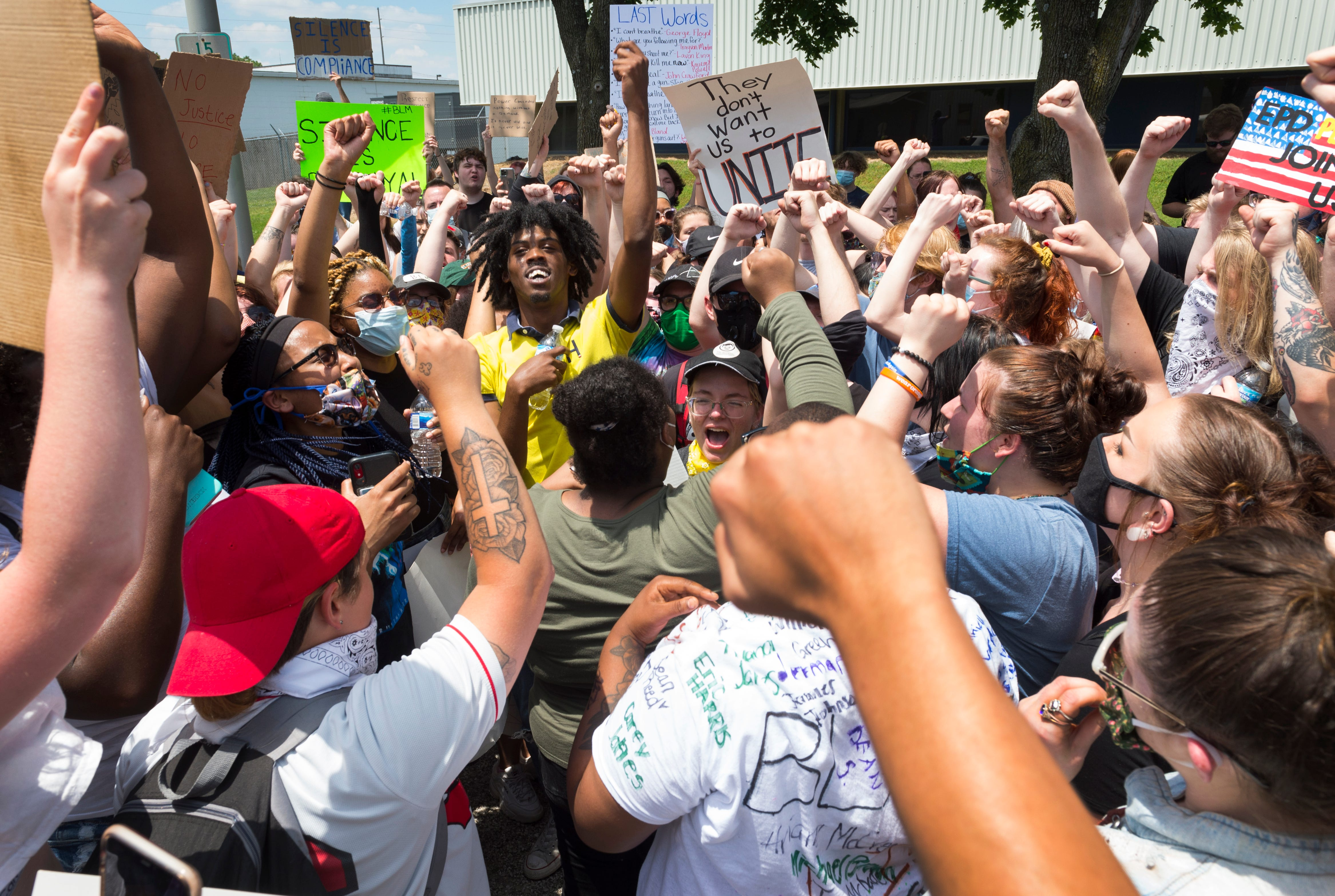 """Protesters gather in a group as they chant """"Unity is power"""" off Carpenter Street in Downtown Evansville, Ind., Wednesday afternoon, June 3, 2020."""