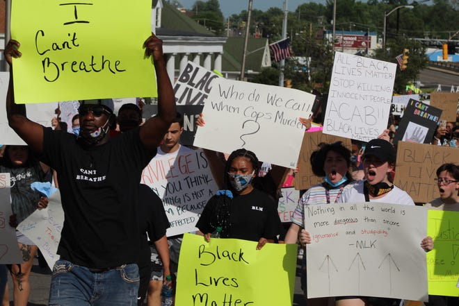 Hundreds of Fremont residents march in protest on West State Street in an anti racism vigil. The march Wednesday evening started at Front Street and extended to Oak Harbor Road before protesters returned downtown.